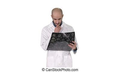 Arabian physician reviewing a MRI brain scan while walking...