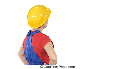 Engineer construction worker woman turning to camera and smiling on white background.