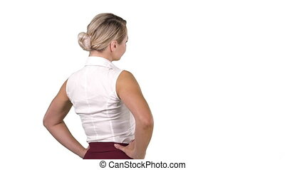 Business woman placing hands on hips on white background. -...