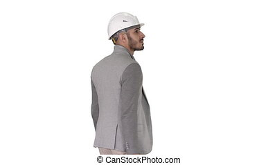 Engineer in helmet with briefcase walking on white...