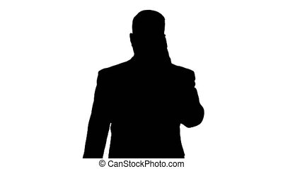 Silhouette Businessman with smartphone, making a phone call....