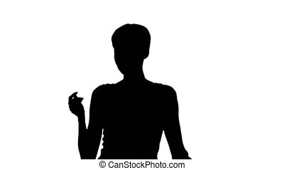 Medium shot. Back view. Silhouette Girl Dancing in Orange SunDress Professional shot in 4K resolution. 023. You can use it e.g. in your commercial video, business, presentation, broadcast