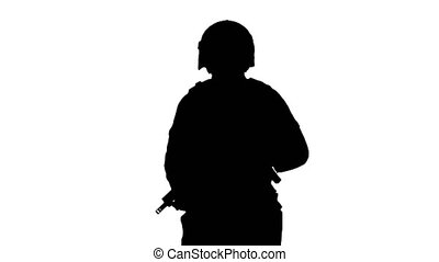 Medium shot. Back view. Silhouette Police tactical unit with a rifle walking. Professional shot in 4K resolution. 067. You can use it e.g. in your medical, commercial video, business, presentation, broadcast