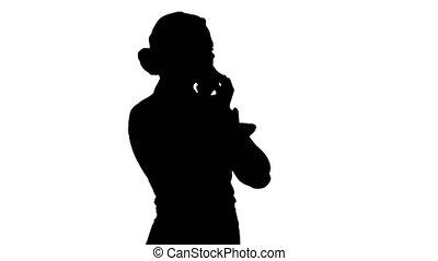 Silhouette Woman talking on the phone. - Medium shot back...