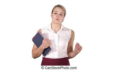 Beautiful teacher with notebooks explaining something to camera on white background.