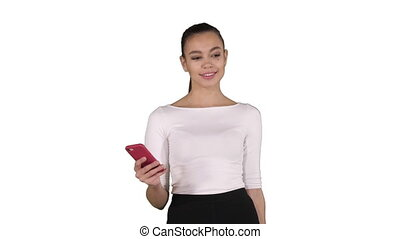 Beautiful young woman using a mobile phone texting on white background.