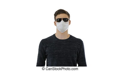 Medium shot. Blind man in face mask and in dark glasses with walking on white background. Professional shot in 4K resolution. 53. You can use it e.g. in your medical, commercial video, business, presentation, broadcast