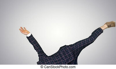 Businessman in suit does break dance moves on gradient background.