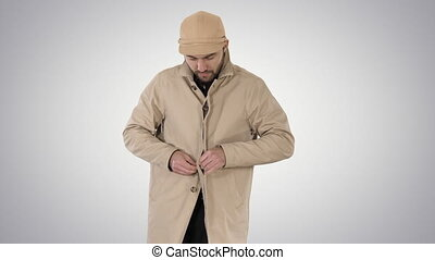 Cold weather Autumn or winter day Man in trench buttons up on gradient background.