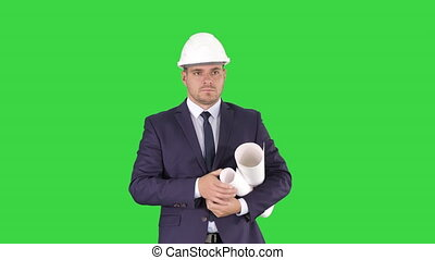 Concept of start up business,architects,engineer holding blueprint in the office or construction site and walking on a Green Screen, Chroma Key.