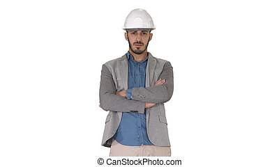 Confident construction engineer architect young man in helmet with hands folded on white background.