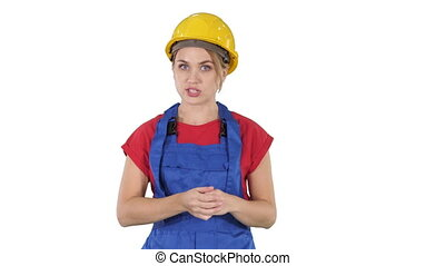 Construction female worket explaining her ideas to camera on white background.