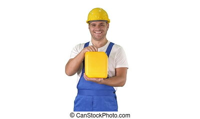 Medium shot. Construction worker advertising construction material in canister on white background. Professional shot in 4K resolution. 014. You can use it e.g. in your commercial video, business, presentation, broadcast