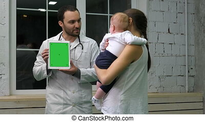 Doctor showing mother and her kid medical results on the...