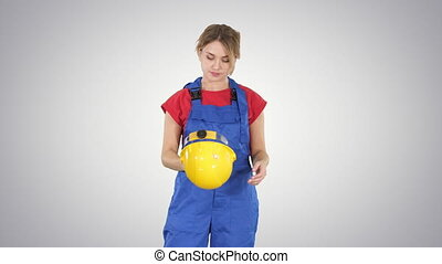 End of working day Construction worker woman taking hardhat...