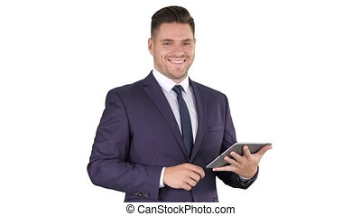 Expressive young businessman with tablet presenting...