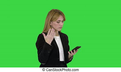 Medium shot. Fail, Loss, Frustrated Woman using Smartphone on a Green Screen, Chroma Key. Professional shot in 4K resolution. 050. You can use it e.g. in your medical, commercial video, business, presentation, broadcast
