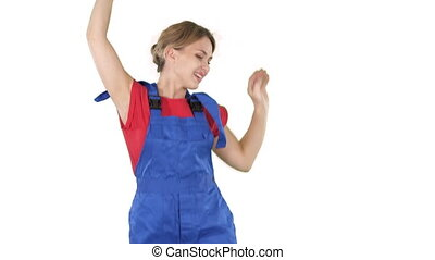 Female construction worker dancing with hardhat on white...