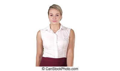 Formaly dressed young woman walking to the camera on white background.