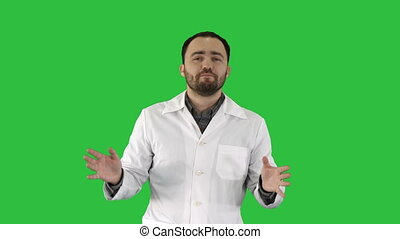 Friendly male medicine therapeutist doctor walking and talking looking in camera on a Green Screen, Chroma Key.