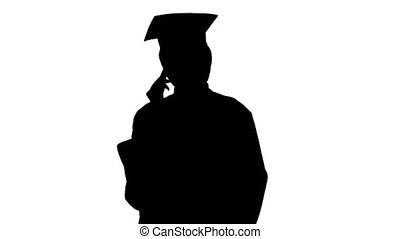 Medium shot. Front view. African American female student in graduation robe talking on the phone, Alpha Channel Professional shot in 4K resolution. 046. You can use it e.g. in your medical, commercial video, business, presentation, broadcast
