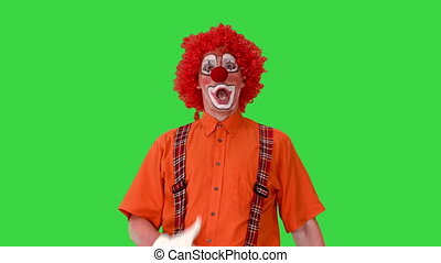 Medium shot. Front view. Funny clown walking like he is marching on a parade on a Green Screen, Chroma Key. Professional shot in 4K resolution. 061. You can use it e.g. in your medical, commercial video, business, presentation, broadcast