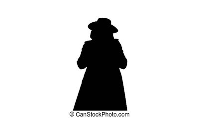 Medium shot. Front view. Silhouette Anonymous wearing Guy Fawkes vendetta mask calling you to join him. Professional shot in 4K resolution. 070. You can use it e.g. in your medical, commercial video, business, presentation, broadcast