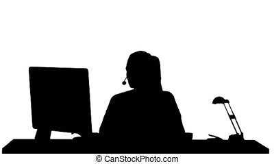 Silhouette Beautiful young casual woman wearing headset working on computer.