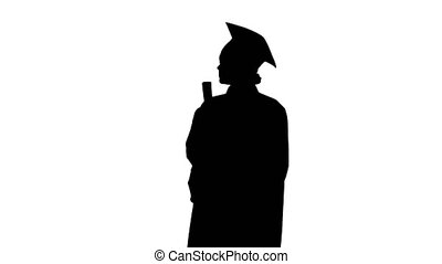 Medium shot. Front view. Silhouette Female student in graduation robe holding diploma and waiving it around. Professional shot in 4K resolution. 043. You can use it e.g. in your medical, commercial video, business, presentation, broadcast