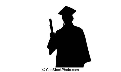 Medium shot. Front view. Silhouette Happy male student in graduation robe waiving with his diploma. Professional shot in 4K resolution. 047. You can use it e.g. in your medical, commercial video, business, presentation, broadcast