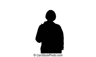 Medium shot. Front view. Silhouette Pleasant carrying doctor lady talking to camera. Professional shot in 4K resolution. 063. You can use it e.g. in your medical, commercial video, business, presentation, broadcast