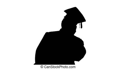 Medium shot. Front view. Silhouette Smiling african american male student in graduation robe talking on the phone sharing happy news. Professional shot in 4K resolution. 051. You can use it e.g. in your medical, commercial video, business, presentation, broadcast