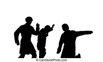 Medium shot. Front view. Silhouette Three male doctors in white robes and protective caps running in the frame and start dancing in a silly way. Professional shot in 4K resolution. 045. You can use it e.g. in your medical, commercial video, business, presentation, broadcast