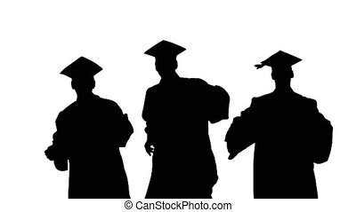 Medium shot. Front view. Silhouette Three male graduates in robes and mortarboards dancing in synch. Professional shot in 4K resolution. 045. You can use it e.g. in your medical, commercial video, business, presentation, broadcast