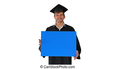Smiling graduate male in mortarboard holding blank sign on white
