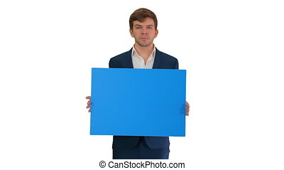 Medium shot. Front view. Young businessman holding blank sign looking at camera on white background. Professional shot in 4K resolution. 047. You can use it e.g. in your medical, commercial video, business, presentation, broadcast