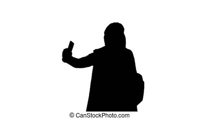 Medium shot. Happy young pregnant woman taking selfie, Alpha Channel Professional shot in 4K resolution. 050. You can use it e.g. in your medical, commercial video, business, presentation, broadcast