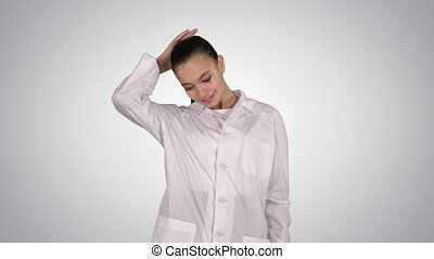Happy young woman doctor dances on gradient background. -...