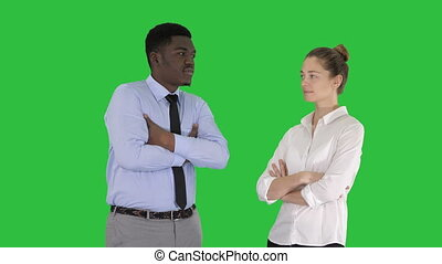 International business people standing with folded arms on a Green Screen, Chroma Key.