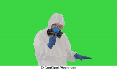 Medium shot. James Bond parody Doctor checking temperature on a Green Screen, Chroma Key. Professional shot in 4K resolution. 53. You can use it e.g. in your medical, commercial video, business, presentation, broadcast