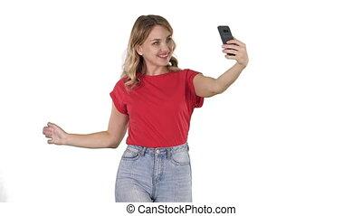 Joyous woman 30s wearing red t-shirt taking selfie photo...