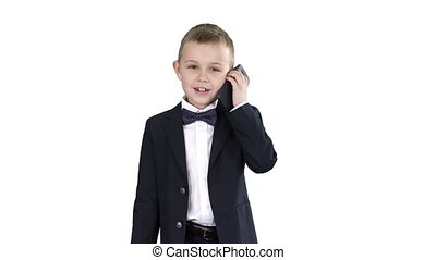Little boy in a costume making a phone call while walking on white background.