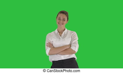 Medium shot. Looking great Marvelous optimistic business woman smiling on a Green Screen, Chroma Key. Professional shot in 4K resolution. 009. You can use it e.g. in your sport, yoga, healthy, commercial video, business, presentation, broadcast