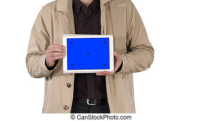 Male hands holding tablet with blue screen mockup on white background.