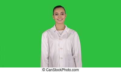 Medical doctor woman going straight on a Green Screen, Chroma Key.