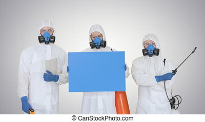 Medium shot. Mockup blue screen. Group of epidemiologists in protective uniform holding blank placard on gradient background. Professional shot in 4K resolution. 53. You can use it e.g. in your medical, commercial video, business, presentation, broadcast