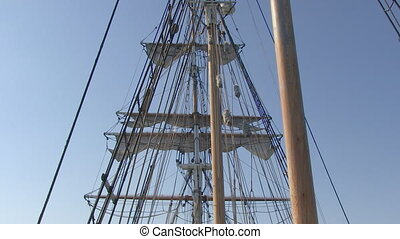 Medium shot of a boat's sail shot - A medium shot of a...