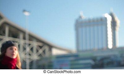 Medium shot of a girl calling a taxi.