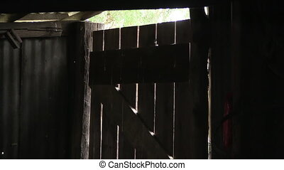 Medium shot of a wooden old door - A medium shot of an old...
