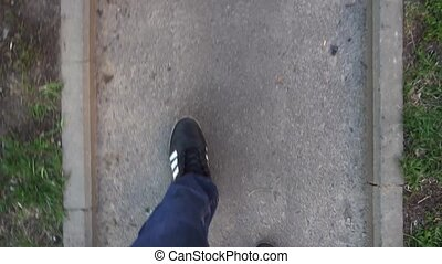 medium shot of feet walking man. First-Person mod.